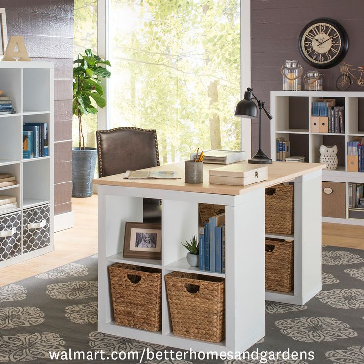 Clever desk idea alert!   If you have a new office to decorate, consider making your own desk out of cube organizers and an old door! The storage is unbeatable and the style speaks for itself.