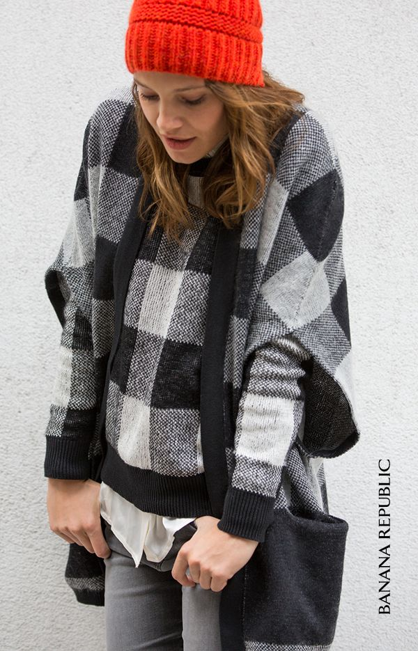 Cool temps call for cozy sweaters, like this buffalo check sweater pullover. Wear the large-scale plaid trend by layering under a cape, or pair with a coat, and bring in a little pop of color (like the orange beanie shown) to really stand out. Wear this look to the office, date night, or home for the holidays.