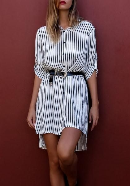 You'll look effortlessly chic in this stylish pinstripe side-slit oversized button-down shirt.