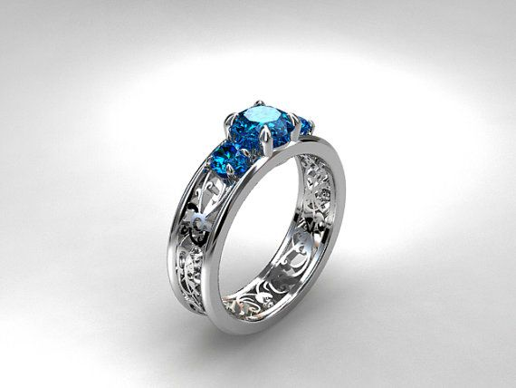 Filigree trinity ring with Swiss blue topazes by TorkkeliJewellery, $1679.00