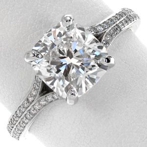 The lovely 2.20 carat cushion cut diamond is accented by the split shank micro pavé band. The double row of diamonds creates a elegant tapper towards the center of the ring.  #engagement #wedding #ring www.knoxjewelers.biz