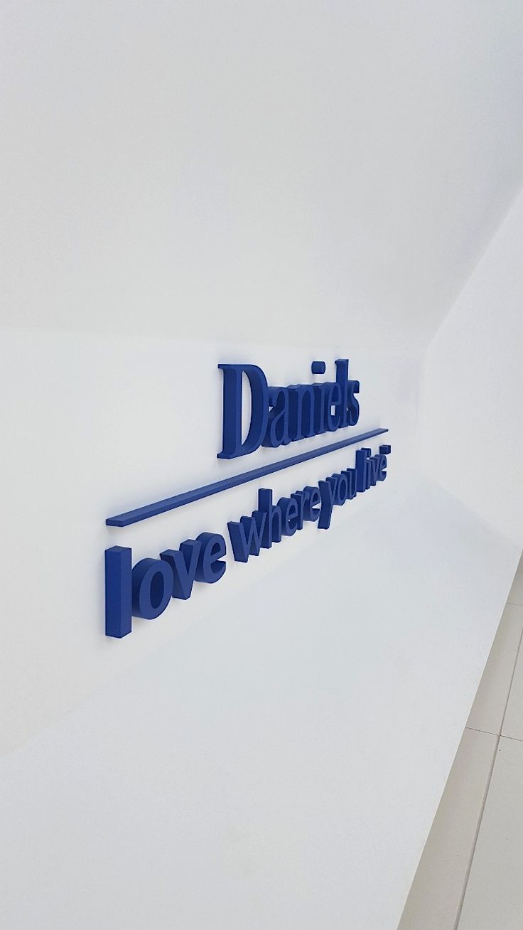 """Daniels Love Where you live, Solutionworx customer, ½"""" painted acrylic installed flat on the wall. Sales centre office signage"""
