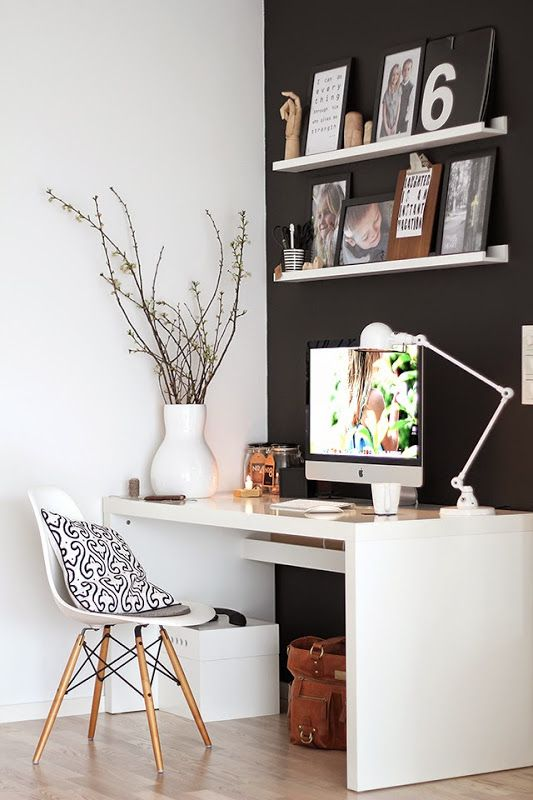 Perfect work corner. Love the eames work chair. Black wall. white Desk.