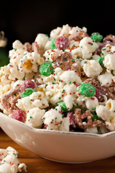Add vanilla candy melts, pretzel pieces, and festively colored M&M's and sprinkles to a bag of popcorn to create this cheery snack.  Get the recipe at Cooking Classy.