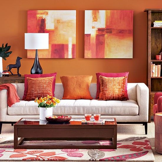 Paprika and beige living room. This exotic shade of orange adds a touch of bohemian chic to this living room. Dark accessories and mango wood-effect furniture add depth to this scheme.