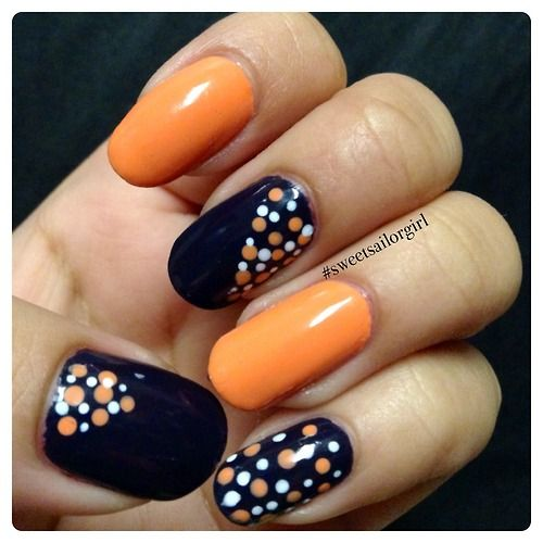 orange and black polka dot nail art
