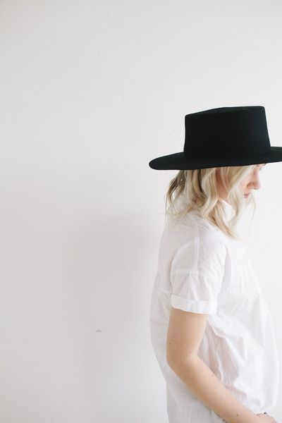 "The Dahlia is a super stiff women's rancher felt wide brim hat. Often referred to as a women's ""Boater"" hat with its flat crown. This classic black is a staple and has a spot in every closet, as it wi"