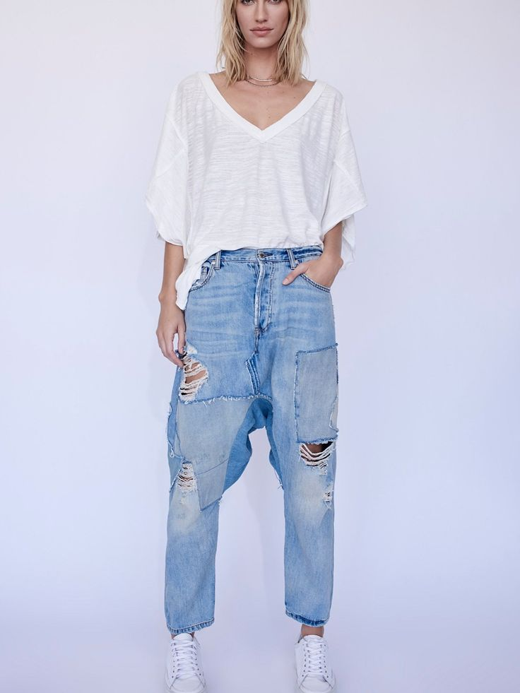 Blazing Summer Harem Jeans | Slouchy harem style jeans featuring denim patchwork detailing and a embroidered bird in back.    * Authentic rigid denim   * Mid-rise   * Five-pocket style   * Button fly