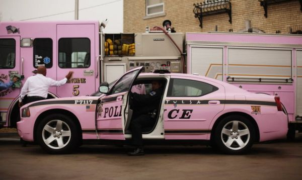 Pink police car and fire truck for breast cancer awarness