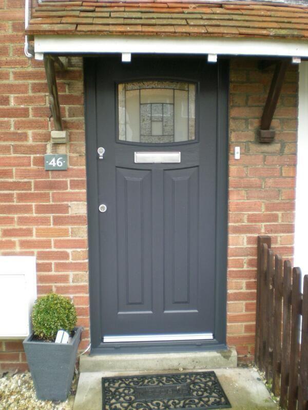 Anhracite grey 1930's style composite door https://upvcfabricatorsindelhi.wordpress.com/ https://stainlesssteelfabricatorsindelhi.wordpress.com/
