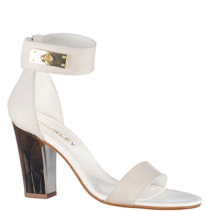 Sandale cu toc inalt de 9,5 cm, marca Thurley de culoare alb pur. Sunt din piele naturala, piciorul fiind fixat printr-o bareta in partea din fata si acoperis si bareta in jurul gleznei in partea din spate.