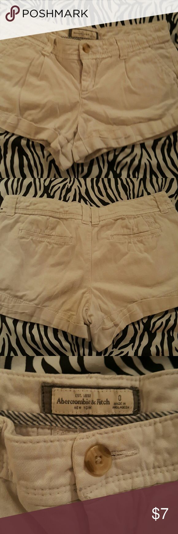 Abercrombie and Fitch beige shorts size:0 Gently used from a non smoking home.  Abercrombie and Fitch beige shorts size 0. Cute for the summer! Abercrombie & Fitch Shorts