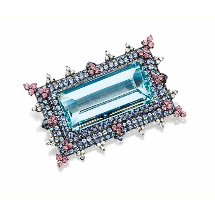 AQUAMARINE, COLOURED SAPPHIRE AND DIAMOND BROOCH Centring on an emerald-cut aquamarine weighing approximately 63.00 carats, framed by circular-cut sapphires, accented by trefoils of brilliant-cut diamonds and pink sapphires, further enhanced with four cabochon sapphires, mounted in 18 karat blackened gold, pendant fitting.