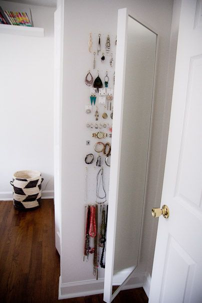 8 Clever Ways to Organize with Ikea • A round-up full of ideas, projects and tutorials! Including, from 'the girl on the go', see how she created this jewelry storage area behind an Ikea mirror.