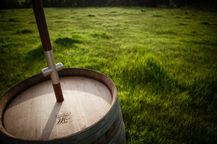 Wine barrels make great rustic umbrella holders while creating a space for guests to sit and relax around. Grand 11mx11m. www.tentluxuryhire.com.au