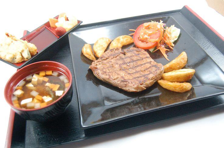 Grilled tenderloin served with sauteed garlic, potato wedges, miso shiru, ebi tempura, fresh fruit & Japanese salad