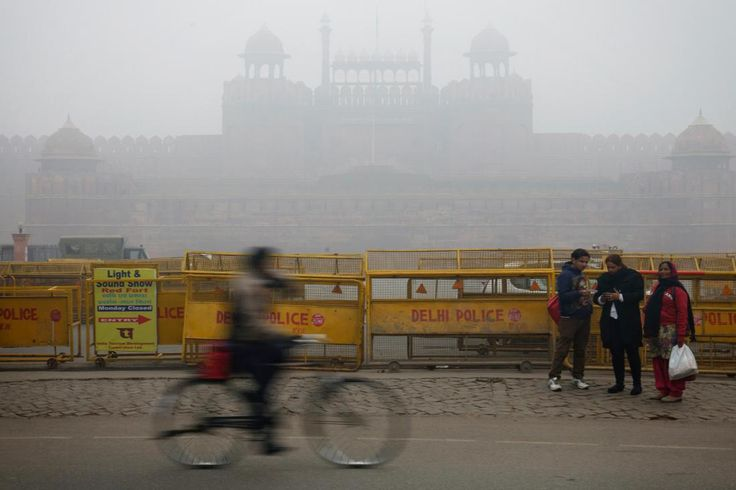 The Red Fort is covered by haze mainly caused by air pollution in Delhi, India on January 20, 2014. Air pollution in India exceeds that of China as diesel fuel subsidies encourage ownership of polluting vehicles. (Kuni Takahashi/Bloomberg)