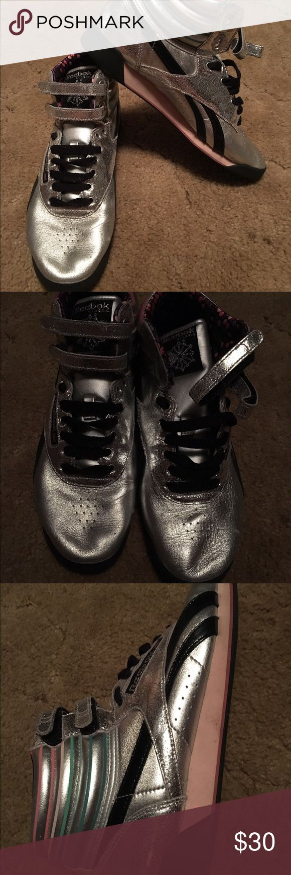 Metallic Silver High Top Reeboks Silver high top Reeboks- Velcro Straps. Worn a couple of times. New condition, but has some stains on the soles Reebok Shoes Sneakers