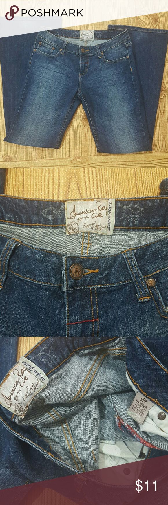 Womens American Rag jeans super flare jeans Womens American Rag jeans super flare jeans Size 9 regular  Front rise 8 inches Back Rise 12 Leg opening 10 inches  Waist  32 inches  Inseam 32 inches  Outseam 41 inches  Pants are in good  condition American Rag Jeans Flare & Wide Leg