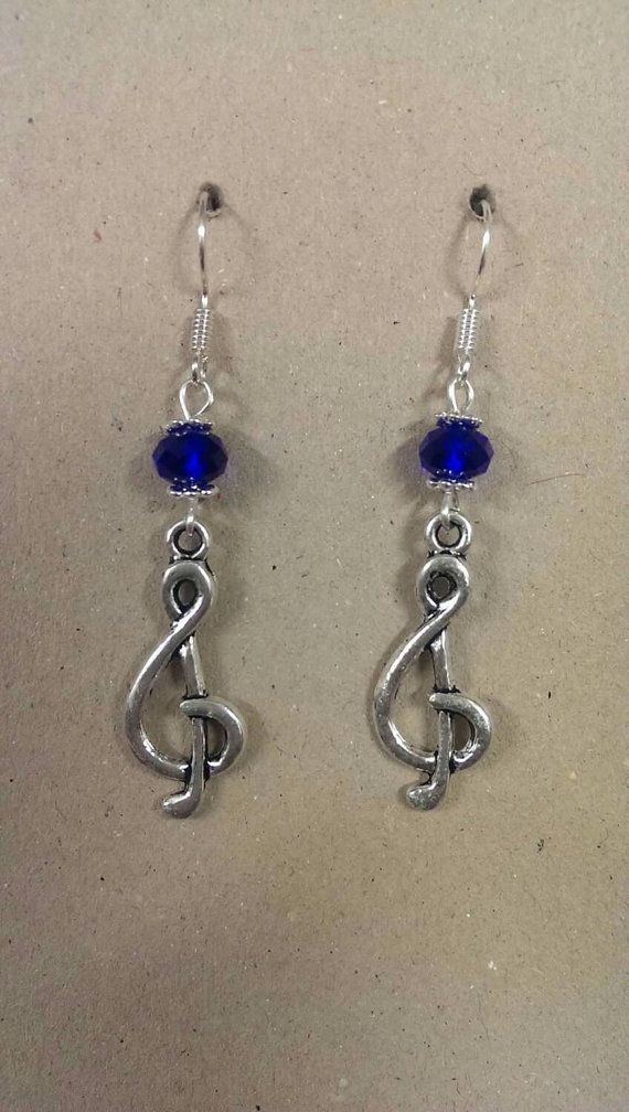 Blue faceted earrings with treble clef charm. by KinleysDesigns