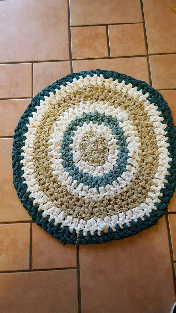 "3/4"" Thick rag rug, made with recycled materials, edges of strips have some frays which is naturally occurring in this type of rug. Frays add to the uniqueness of this type of rug as it is common for raw edges of the material to fray as it is incorporated into the design. 