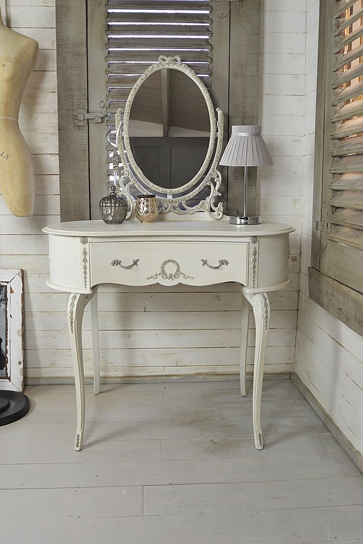 This delightful petit French Louis dressing table has been painted in Old  White with Paris Grey inner drawers, handles and detailing.
