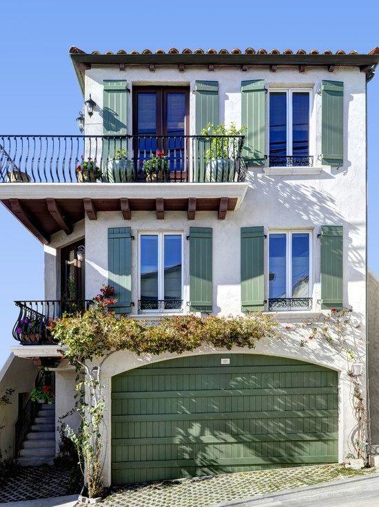 iron ballustrade + perfect green shutters/garage door