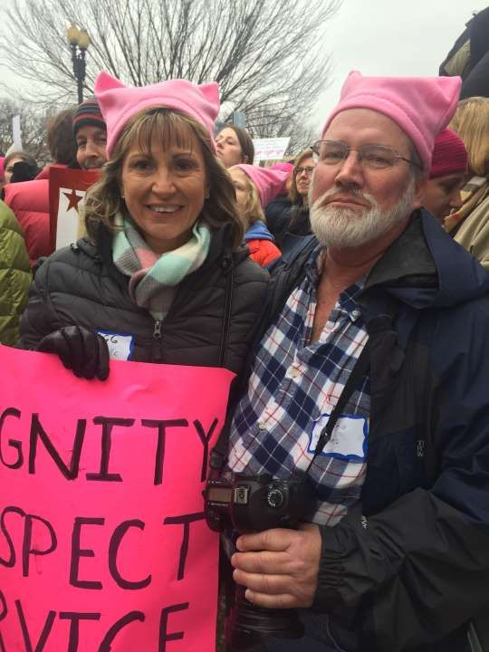 What was the role of men at a march full of women?  January 22, 2017  -     Michael Tobin, 57, stands with his wife.