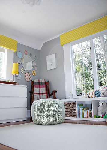 Grey Nursery with Citrus Accents. Lovely gender neutral decor -- the shelving unit in front of the window is perfect storage and cat perch