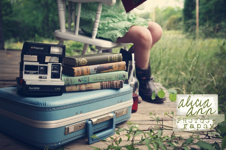 nomad traveler suitcase travel photography polariod books reader lifes travels