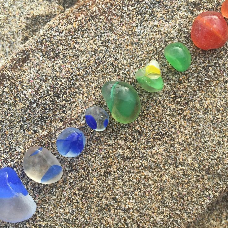 Rainbow marble pieces #beach #beachglass #seaglass #oldmarble #marble #broken #smooth #red #blue #green #yellow #line #sand #luminous #simple #rainbow #oldtoy #worn #wornsmooth #smooth #japanese