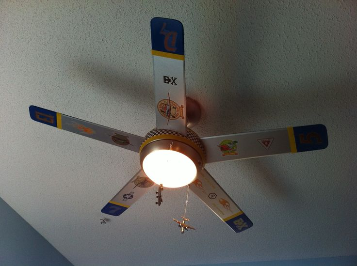 A painted ceiling fan to resemble the propeller from an airplane. We did this for my son's Planes room. I found some inexpensive toy airplanes at the Dollartree store for the pull strings.