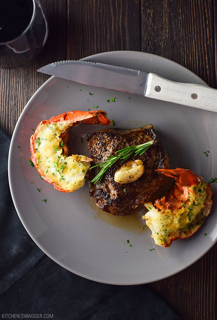 A super easy surf and turf recipe for two, made with buttered, baked lobster tails and a pan-seared NY strip steak cut in two.