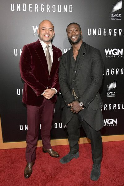 "Aldis Hodge Photos Photos - Director/Executive producer, Anthony Hemingway (L) and actor Aldis Hodge attend WGN America's ""Underground"" Season Two Premiere Screening at Regency Village Theatre on March 1, 2017 in Westwood, California. - WGN America's ""Underground"" Season Two Premiere Screening"