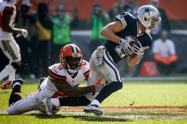 Cowboys vs. Browns:  35-10, Cowboys  -  November 6, 2016  -   Cleveland Browns cornerback Jamar Taylor (21) tackles Dallas Cowboys wide receiver Cole Beasley (11) in the first half of an NFL football  game, Sunday, Nov. 6, 2016, in Cleveland. (Credit: AP / Ron Schwane)