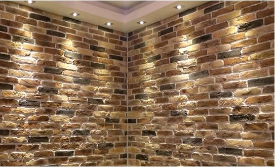 Stunning blend of Rustic Brick Slips perfect for feature walls and enhanced by top quality wall lighting