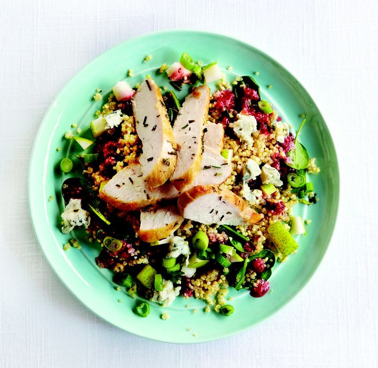 This hearty, warm salad from Clean Eating featuring quinoa and millet makes a nutritious dinner or lunch. Roasted chicken is served atop a quinoa-millet grain salad sprinkled with pears and crumble...