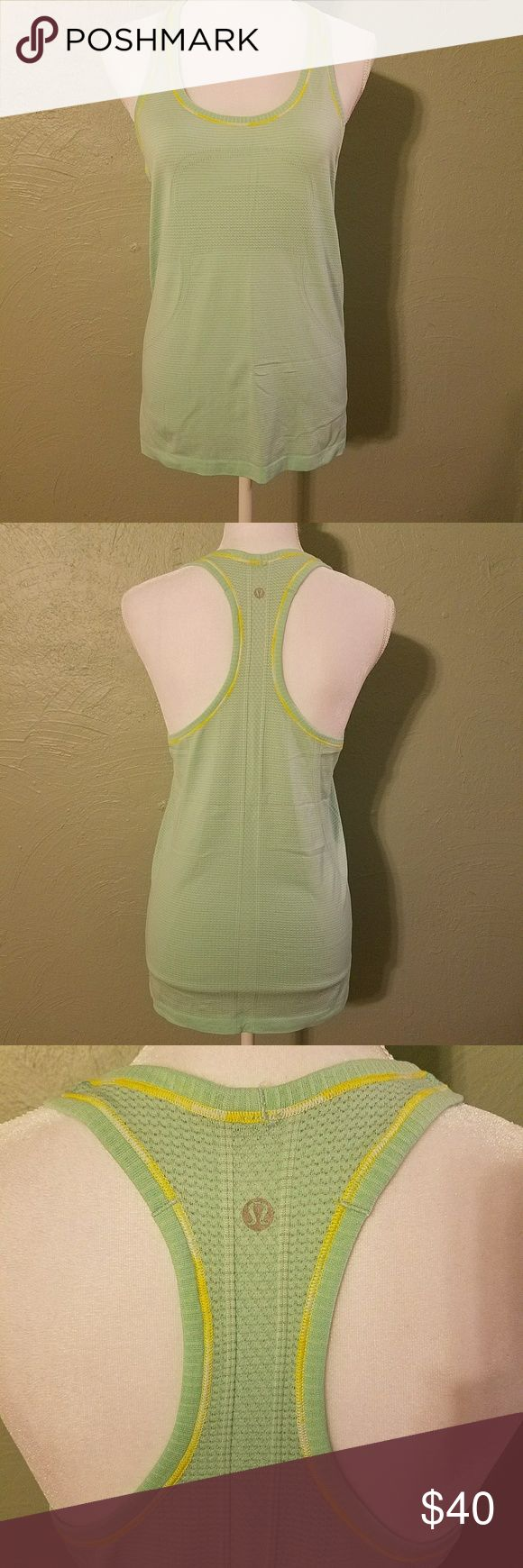 Lululemon Athletica Tank Top This is a mint green Lululemon Athletica racer back tank top. It has the Lululemon logo subtly across the front of the torso of the shirt. The stitching is yellow. Super cute! In perfect condition. lululemon athletica Tops Tank Tops
