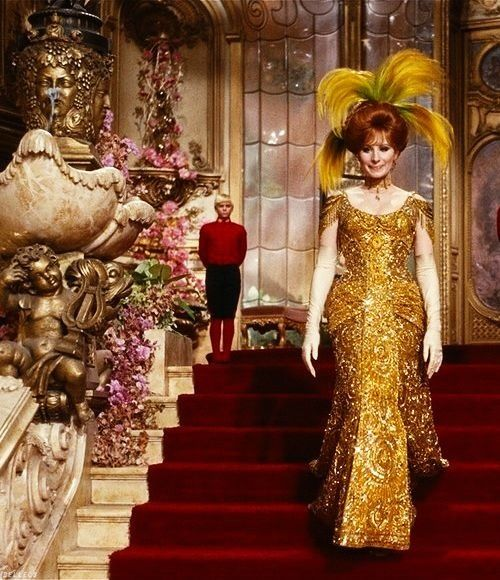 Hello, Dolly! The original design of Barbra Streisand's gold-beaded gown shown in the Harmonia Gardens scene weighed 40 pounds and cost $8,000. Twice during rehearsals, she tripped over its 2.5-foot train. Other dancers also tripped over it during rehearsal, so the train was taken off the dress. The train is shown intact when Streisand starts down the stairs, but later it disappears. See HELLO, DOLLY! live on stage with Music Circus at the Wells Fargo Pavilion JUNE 28-JULY 3, 2016. TICKETS…