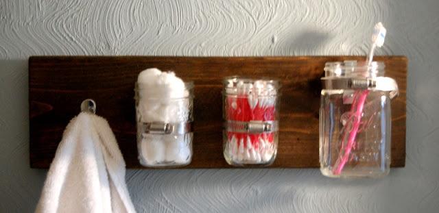 Awesome DIY bathroom storage by @Jennifer Milsaps Corazzo using mason jars, scrap wood and a towel hook