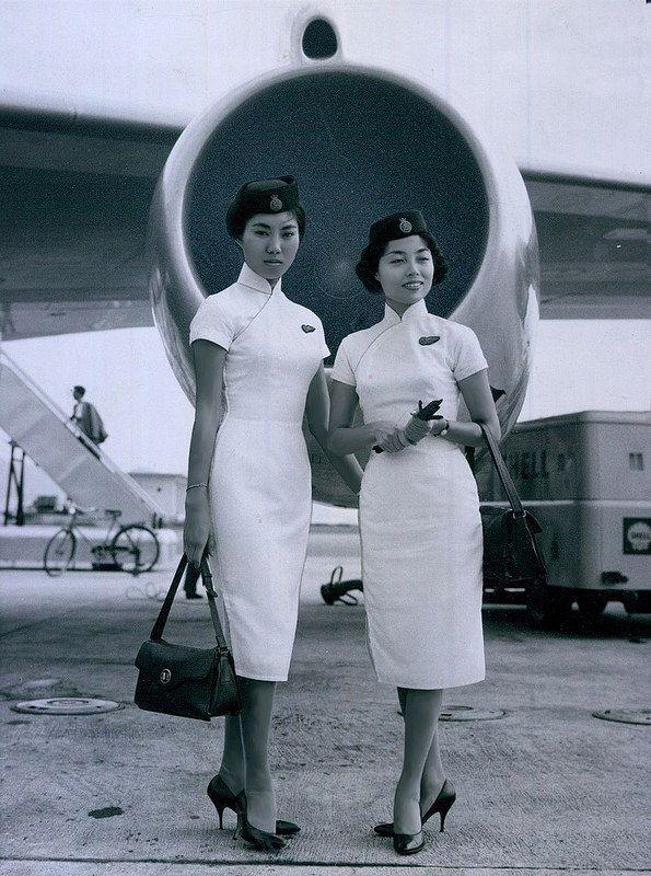1962 Cathay Pacific Air stewardess. Kai Tak, Hong Kong.