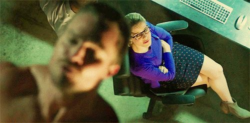 Pin for Later: Shirtless Pull-Ups and More Reasons That Arrow Is TV's Sexiest Show That's his tech genius partner, Felicity, watching him.