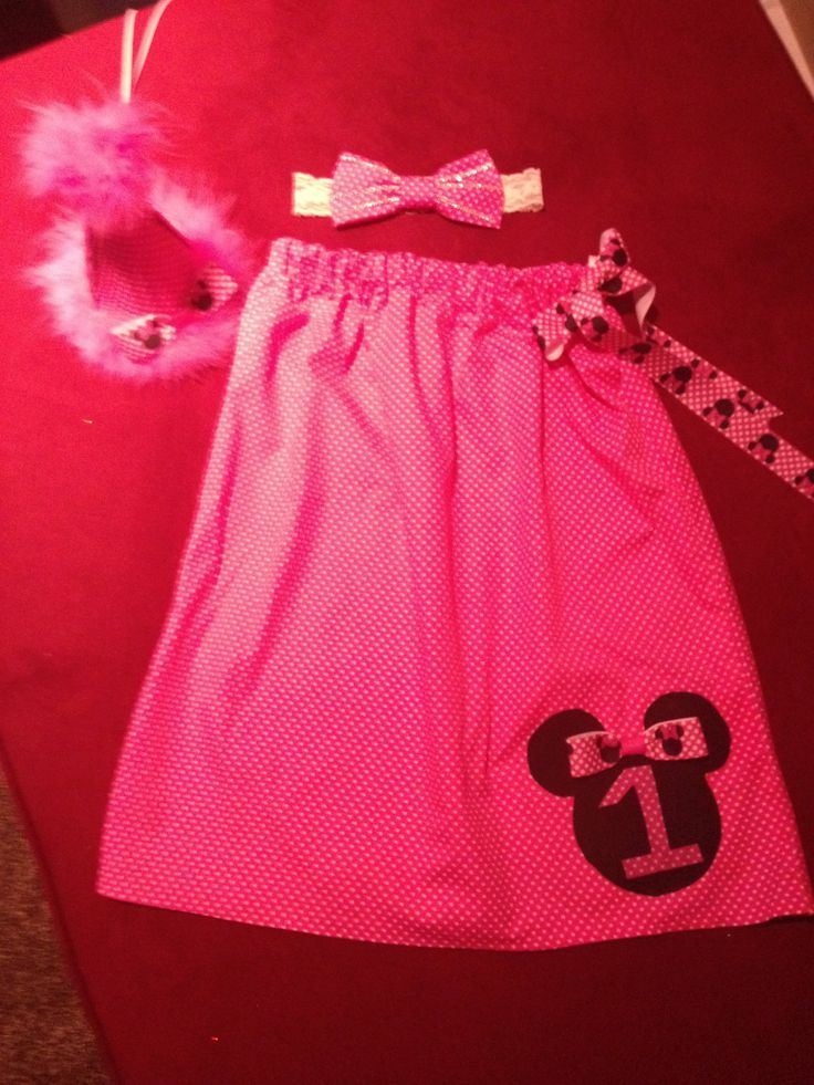 this pillowcase dress and party hat i made for my baby girl when she turned 1year old  her birthday party theme was Minnie mouse