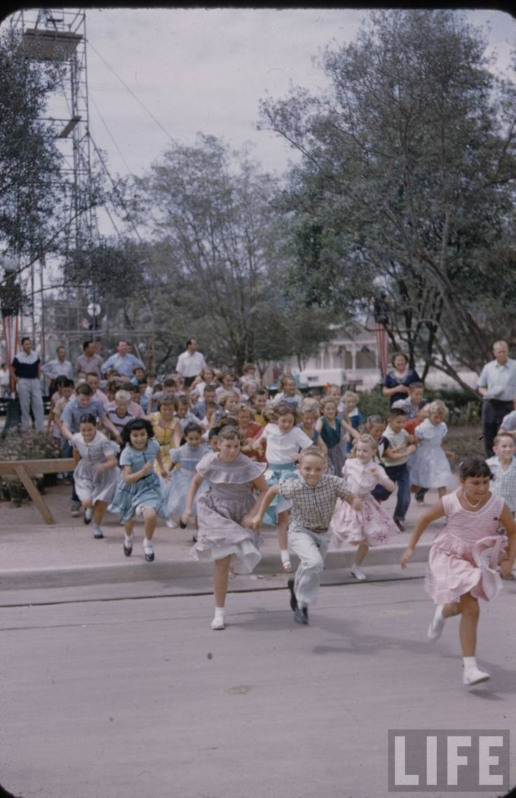 Children run to Sleeping Beauty Castle to be the first to enter Fantasyland on Disneyland Opening Day, 1955.