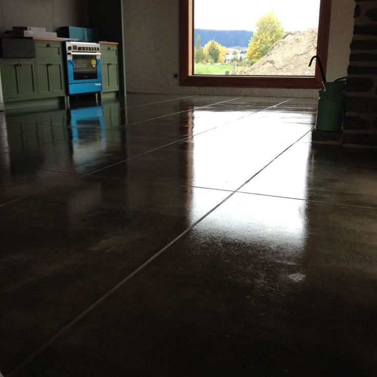 Concrete floor - cut tiles, grouted and coated