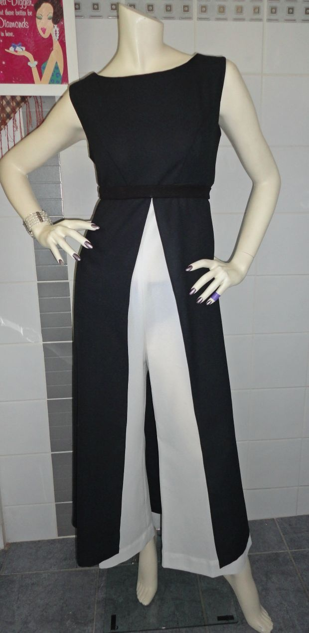 Rare 1960's pantsuit-jumpsuit This beautiful piece was a rare find in my travels and has been dry-cleaned & pressed. In excellent condition for it's age.