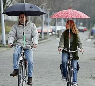 This, it seems, is an actual thing... and I want one!!! Umbrella holder for bicycle - stylish bike accessories by Bike Belle