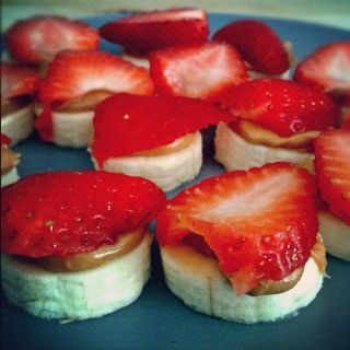Quick and easy healthy snack. Banana-peanutbutter-strawberry sandwiches.-- could totally make this weight watchers with PB2