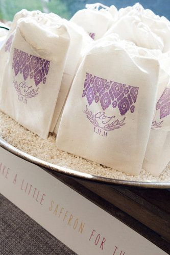 This pretty sachet contains the bride's grandma's paella recipe, a pouch of saffron, and a drawing by her grandpa.  Share your favorite secret or not-so-secret recipe that everyone always asks you about and perhaps even one of its ingredient to go along with it.  Photo by Anna Sawin Photography via Style Me Pretty