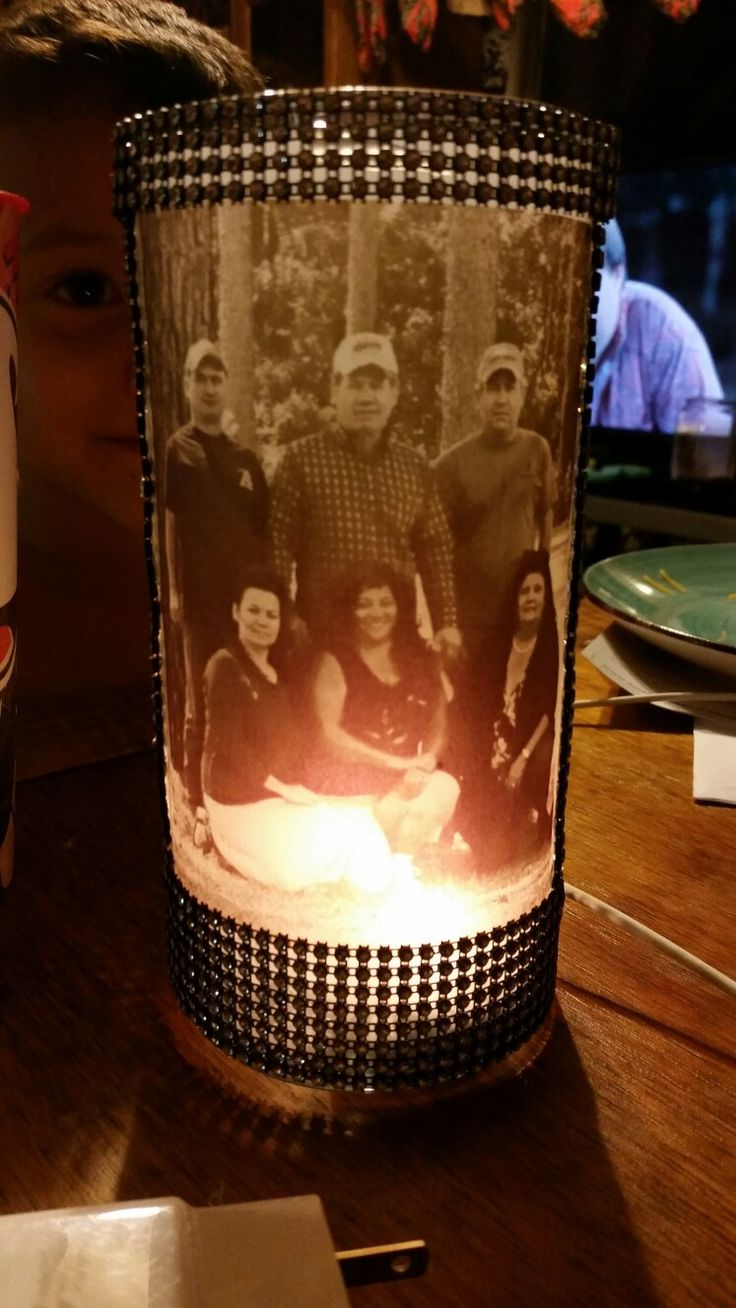 """picture in sepia tone printed on vellum paper. use an adhesive to stick to a clear vase (bought a 7"""" clear vase from WalMart for 97 cents). double sided tape or glue works. i sert a tea light candle."""